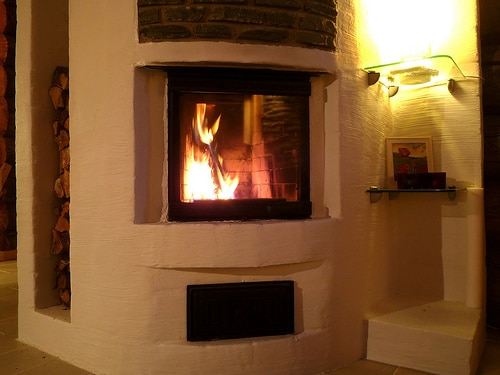 Earth friendly cabins which fireplace to choose trulog for Choosing a fireplace