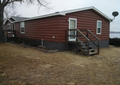 A job we shipped to ND. It is a double wide home with our canyon red siding & canyon red accessories