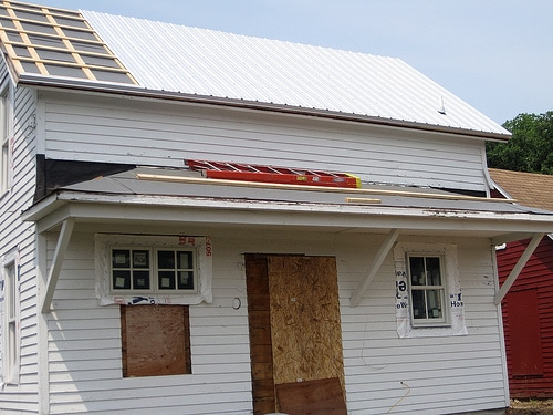 Install A Metal Roof With Your Steel Log Siding