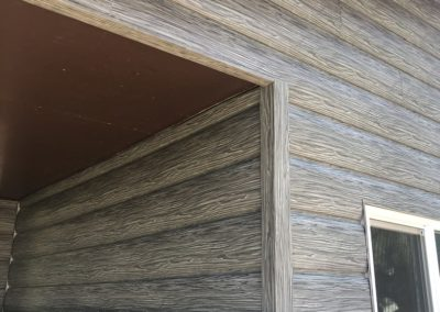 Weathered Gray Steel Log Siding